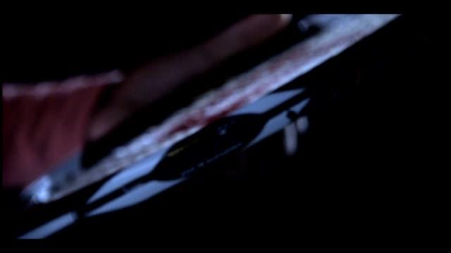 unidentifiable african american female holding wilson brand tennis racket, hands adjusting strings. - tennis racket stock videos & royalty-free footage
