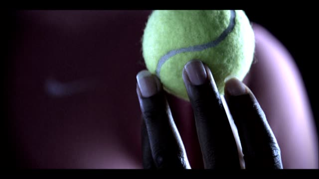 unidentifiable african american female left hand holding rotating playing w/ tennis ball in hand - tennis racket stock videos & royalty-free footage