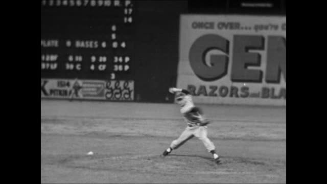 unidentifiable baseball player fielding ball from baseline ws field lights unidentified pitcher pitching unidentified batter hitting running to first... - ebbets field video stock e b–roll