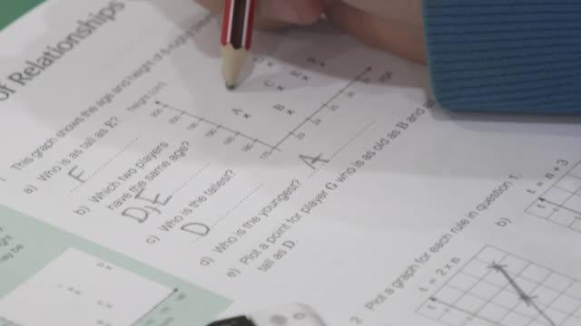 unidentifiable boy doing maths homework - homework stock videos & royalty-free footage