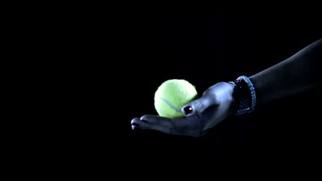 unidentifiable female hand holding tennis ball flipping ball over serve - tennis racket stock videos & royalty-free footage