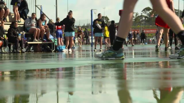 unidentifiable girls playing school netball - teenage girls stock videos & royalty-free footage