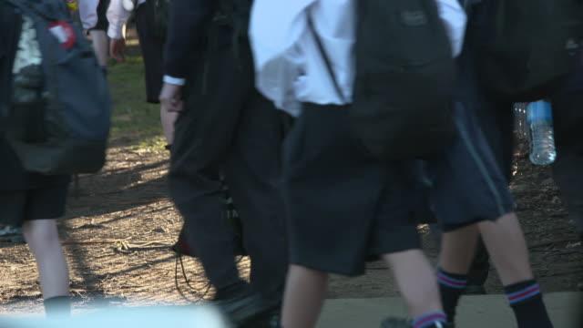 unidentifiable high-school students walking outside school. - uniform stock videos & royalty-free footage