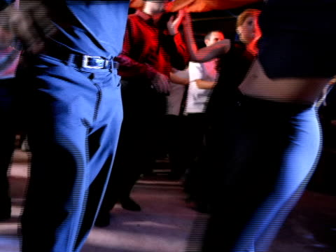 unidentifiable male female couple hips only dancing salsa in crowded club people mostly out of focus dancing bg - salsa stock videos & royalty-free footage