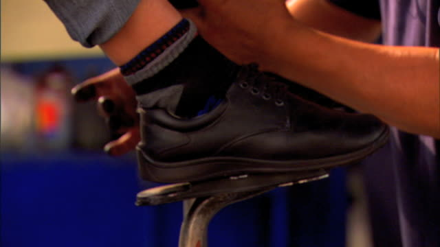 Unidentifiable male shoeshiner shinning another person's shoes w/ polish on street Boot polisher shoe polish bootblacks