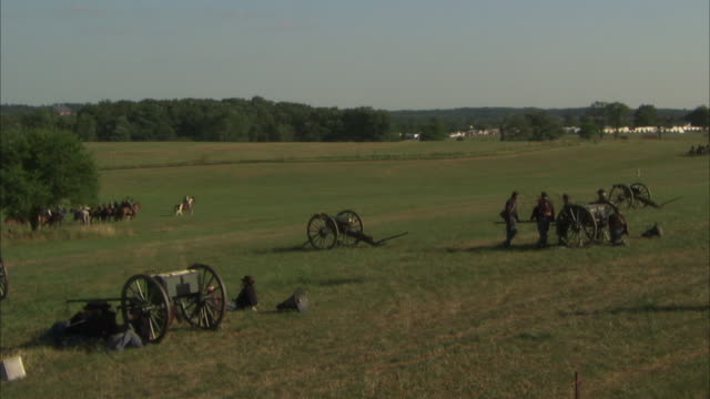 unidentifiable union army soldiers standing by traveling forge on field fg mounted infantry of confederate state army cavalry on horseback on field... - union army stock videos & royalty-free footage