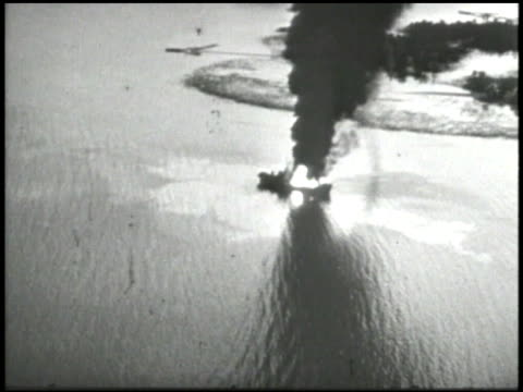 Unidentified bombers in overhead flight AERIAL WS Diving toward ship on fire in flames burning pulling up TU Single aircraft in flight AERIAL Machine...