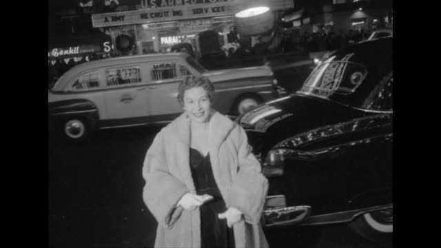 Unidentified celebrity in fur coat arrives at the NYC movie premiere of The Eddie Cantor Story