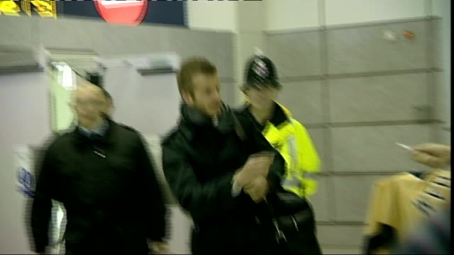unidentified location: **flashlight photography** david beckham signing autographs at airport arrivals area - achilles tendon stock videos & royalty-free footage