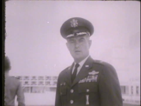 unidentified male general standing outdoors saluting cadets walking by talking to camera about training cadets to be highly motivated individuals to... - general military rank stock videos and b-roll footage