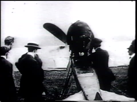 unidentified man climbing into british aircraft manufactured by howard t wright designed by wo manning vs plane moving on ground aerial seashore... - 1910 stock-videos und b-roll-filmmaterial