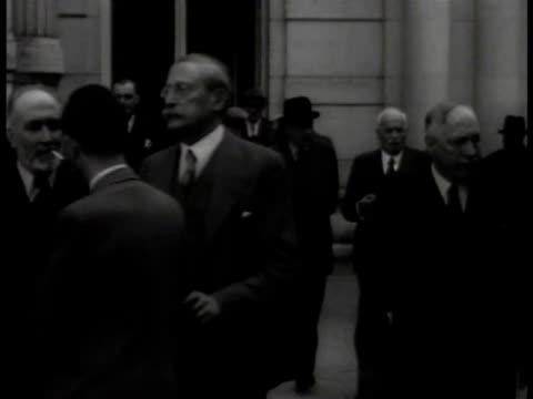 unidentified man walking w/ jewish socialist leon blum (1872-1950, leon shaking man's hand. french generals standing together, maxime weygand talking... - judaism stock videos & royalty-free footage
