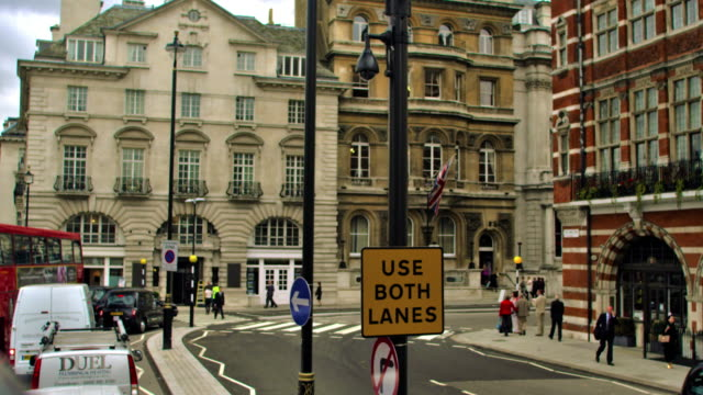 london - october 11: unidentified people along a busy street with tall buildings on october 11, 2011 in london - road sign stock videos & royalty-free footage
