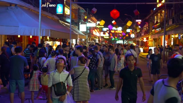 unidentified tourists walking in pub street at siem reap, cambodia - cambodia stock videos and b-roll footage