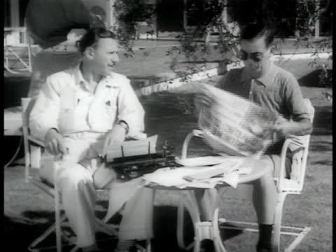 Unidentified writer w/ comedian Eddie Cantor in backyard SOT Eddie looking in paper for joke ideas writer picking story Eddie making political...