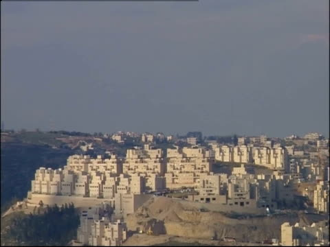 uniform stone buildings cover a hilltop in bethlehem. - palestinian territories stock videos and b-roll footage