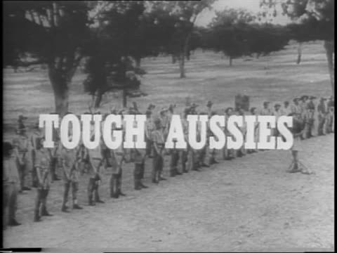 uniformed australian soldiers stand in line then start running / long shot of soldiers crawling through obstacle course amid explosions / long shot... - army soldier stock videos & royalty-free footage