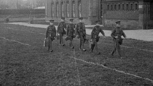 1925 montage uniformed band members of the officers training corps. playing and marching across school grounds, and members of the field wireless section set up and operate their equipment at secondary school / newcastle upon tyne, england, united kingdom - military school stock videos and b-roll footage