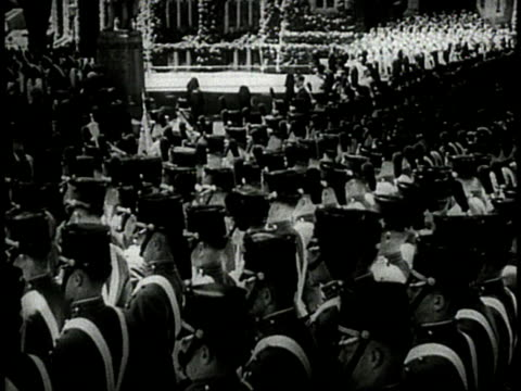 uniformed cadets standing at attention in formation / cadets one of them black bringing rifles to their shoulders / new york usa - 1944 stock videos and b-roll footage