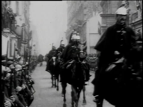 uniformed cavalry parading down crowd-lined streets / paris, france - cavalry stock videos & royalty-free footage