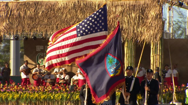 uniformed men carrying flags of united states and guam at opening ceremony of 12th pacific arts festival in guam - グアム点の映像素材/bロール