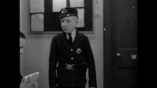 montage uniformed messenger boy arriving in postal office for his first day on the job, and being directed to the medical office for an exam / england, united kingdom - boy medical exam stock videos and b-roll footage