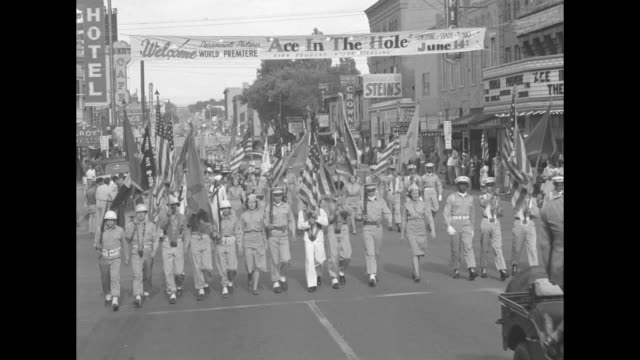 """uniformed people carrying american flags march under a banner """"ace in æthe hole"""" / crowd of spectators facing right / sound truck / kirk douglas... - kirk douglas actor stock videos & royalty-free footage"""