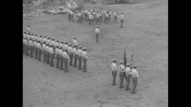 uniformed prison cadets marching in formation with prison walls beyond / the color guard with the american and new york state flags as a marching... - prison guard stock videos and b-roll footage