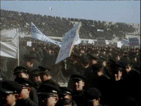 Uniformed protestors march carrying banners at South Korean anticommunist demonstration Seoul 01 Feb 68
