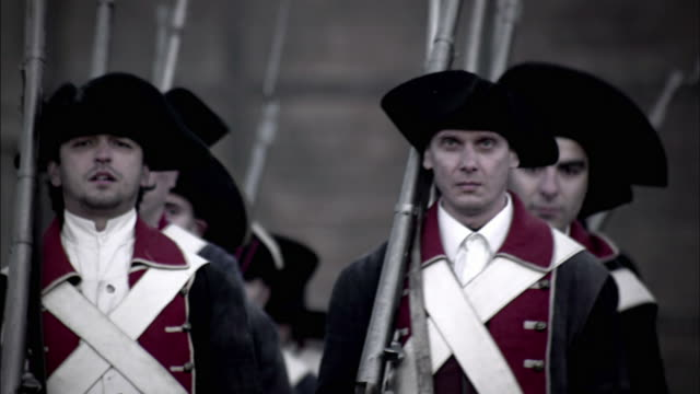 uniformed soldiers march during a reenactment of the storming of the bastille. - french revolution stock videos & royalty-free footage