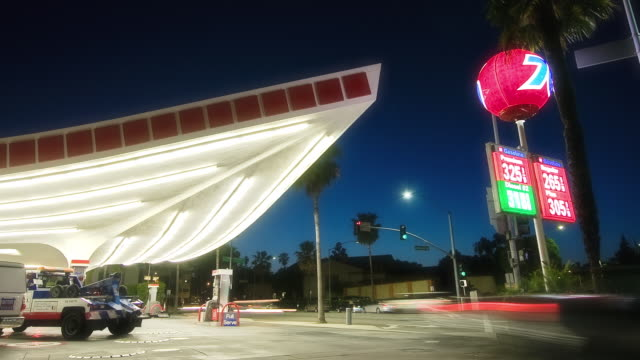 T/L MS LA Union 76 gas station built in Streamline Moderne style, dusk to night, Beverly Hills, California, USA