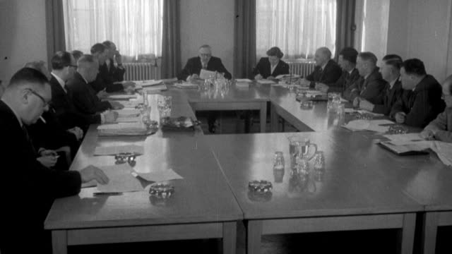 1955 montage union and employer representatives in a meeting discussing wage plans / united kingdom - local politics stock videos & royalty-free footage