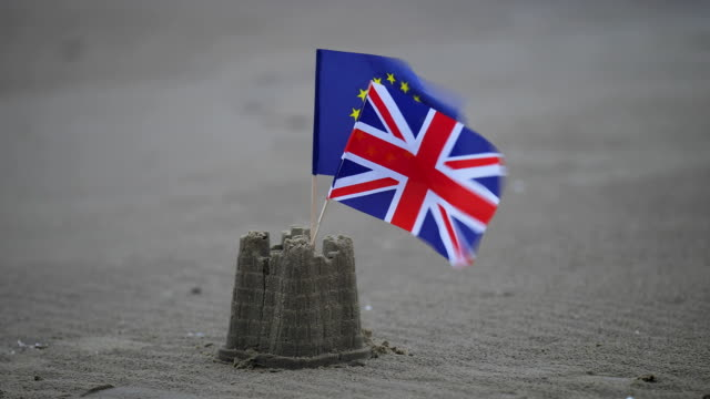 union and eu flags in sandcastle - brexit stock videos & royalty-free footage