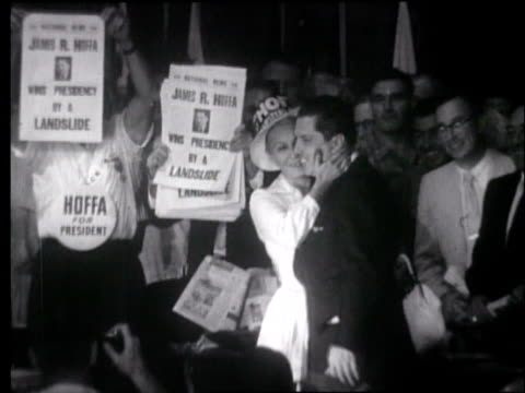 union delegates arriving at teamster national convention in miami in 1957, carrying signs reading hoffa for president and bill lee for president /... - trade union stock videos & royalty-free footage