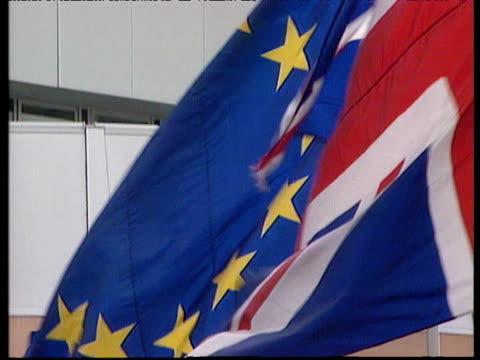 Union flag flying in breeze European Union flag behind it.