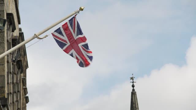 union jack blows in wind in edinburgh old town - pinnacle stock videos & royalty-free footage