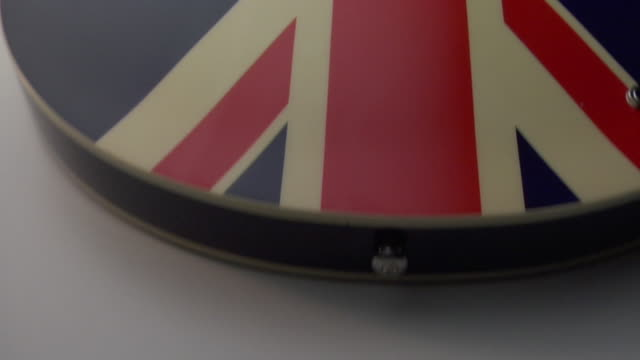 ecu, cs, union jack electric guitar on white background - electric guitar stock videos and b-roll footage