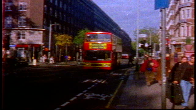 union jack flag and double decker bus in london on super 8 film - grainy stock videos & royalty-free footage