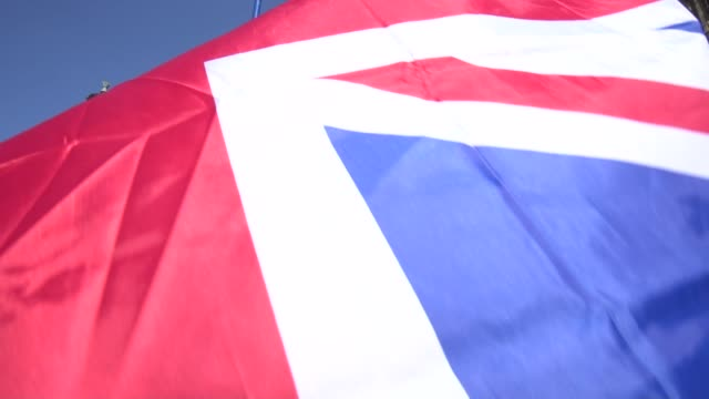 Union Jack flag blowing in breeze outside Houses of Parliament in Westminster