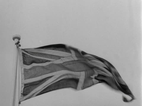 a union jack flag blows in the wind - union jack stock videos & royalty-free footage
