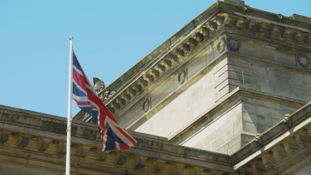 union jack flag blows in wind - union jack stock videos & royalty-free footage