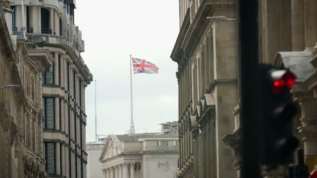union jack flag flies above bank of england - symbol stock videos & royalty-free footage