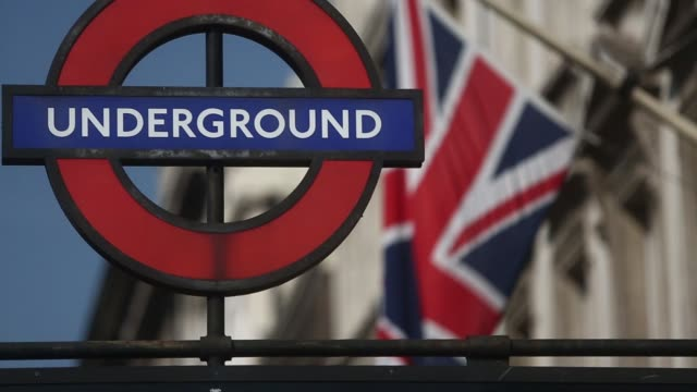 A Union Jack flag hangs from a mast next to a sign for Westminster London Underground station in London UK on Monday Sept 8 Pedestrians and vehicles...