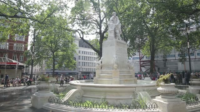 stockvideo's en b-roll-footage met union jack flag hangs next to a street sign for leicester square in london on monday, aug 4 various shots people sitting on benches or walking past a... - alle vlaggen van europa