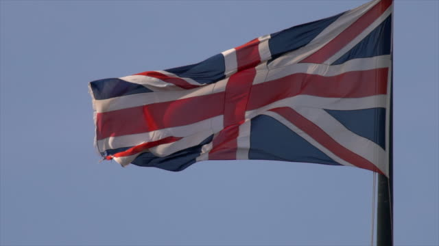 union jack flag in slow motion - politics icon stock videos & royalty-free footage