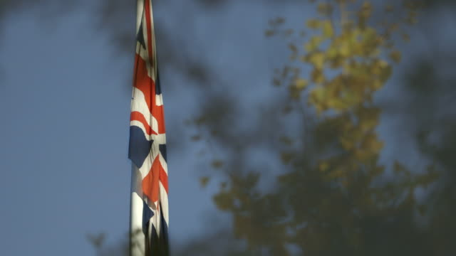 a union jack flag outside the british ambassador's residence in washington dc moves gently in the breeze, usa. - british flag stock videos and b-roll footage