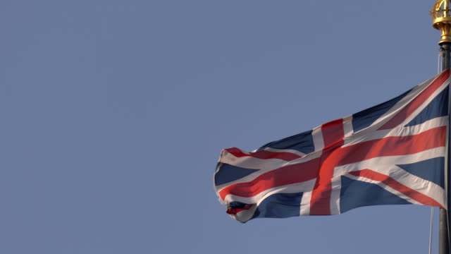 union jack flag with copy space to the left - politics icon stock videos & royalty-free footage