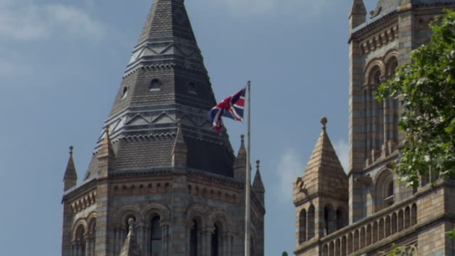 CU, Union Jack flag with tower of Natural History Museum in background, London, England