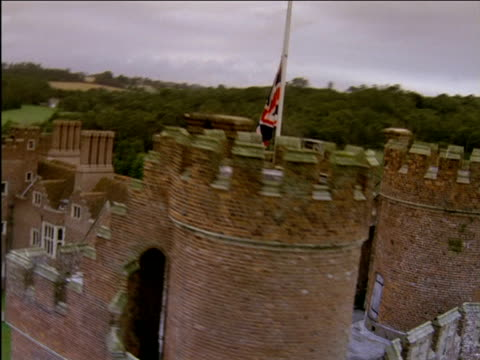 union jack is raised on flagpole at herstmonceux castle and surrounding gardens - union jack stock videos & royalty-free footage