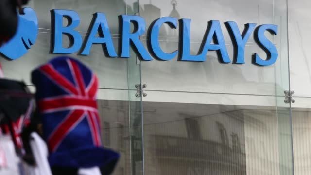 stockvideo's en b-roll-footage met union jack souvenir goods are displayed for sale at a stall outside a barclays plc bank branch in central london, uk, on wednesday, may 7 pedestrians... - alle vlaggen van europa